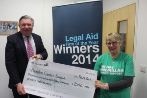 Newcastle Law Society President Mark Harrison donating money raised through the Law Society to Macmillan